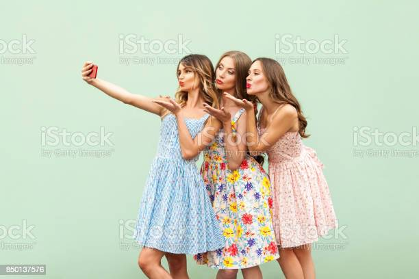 Happiness three young adult model macking selfie and send air kiss in picture id850137576?b=1&k=6&m=850137576&s=612x612&h=kspopo fu8cxz7kq4jhnll8dqznz l17kih3fdiuubg=
