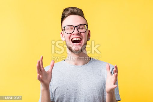 1045527172 istock photo happiness thrilled man emotion feeling expression 1152310237
