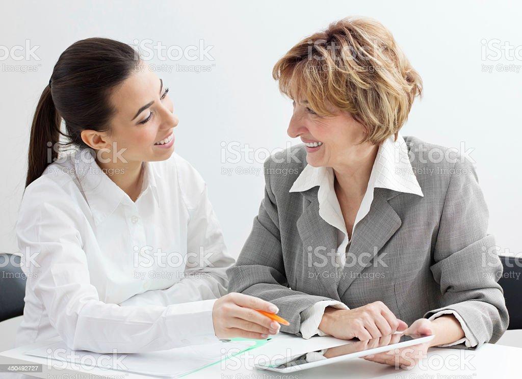 Happiness two businesswomen team stock photo