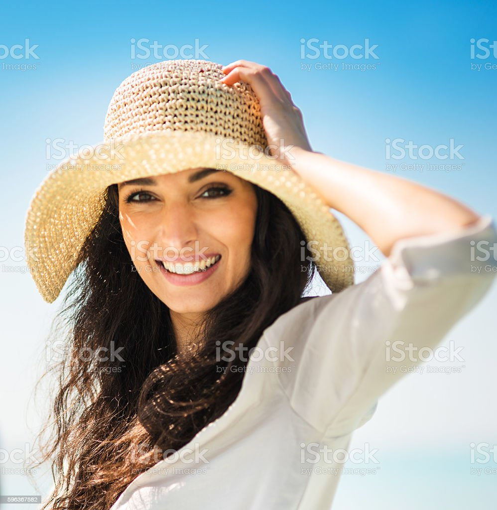 Happiness woman on summer with panama hat stock photo