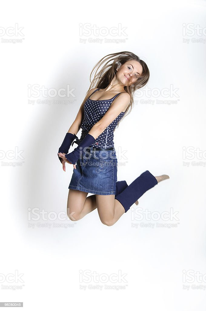 happiness woman to jump up in a white backgrounds royalty-free stock photo