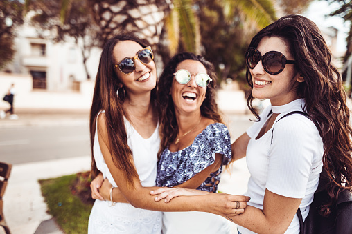 700702502 istock photo happiness women embracing on the city 1060120500