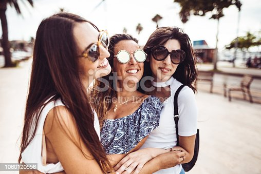 700702502istockphoto happiness women embracing on the city 1060120556