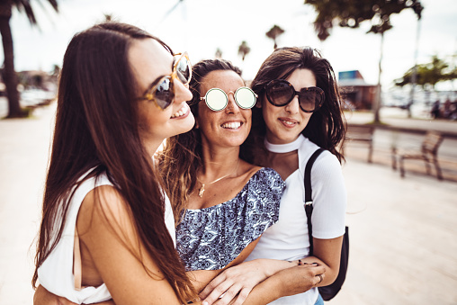700702502 istock photo happiness women embracing on the city 1060120556