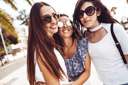 700702502 istock photo happiness women embracing on the city 1060629406
