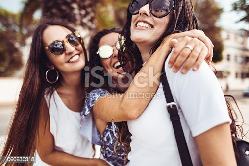 700702502istockphoto happiness women embracing on the city 1060630318