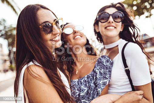 700702502istockphoto happiness women embracing on the city 1060630456