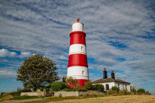 Happisburgh lighthouse situtated in Norfolk in beautiful autumnal sunshine stock photo