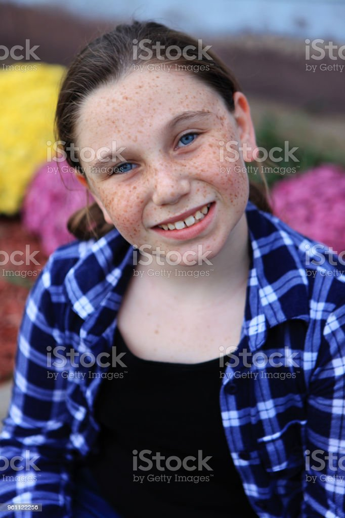 Happy 10 year old girl in plaid shirt stock photo