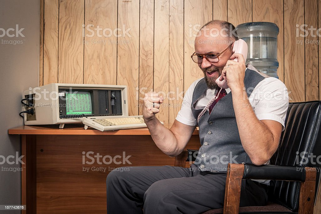 Happy 1980's sales man worker nerd  on phone at cubicle royalty-free stock photo