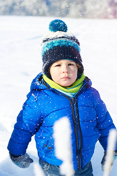 Happy 2 years baby boy on walk in winter park stock photo