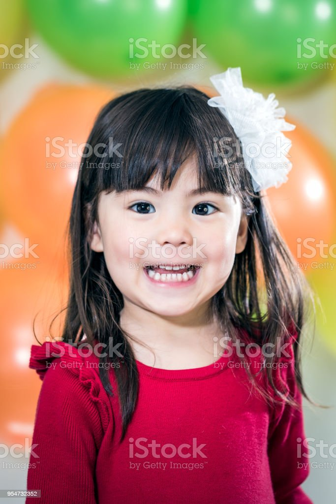 Happy 3 Year Old Girl In Front Of Birthday Balloons Royalty Free Stock Photo