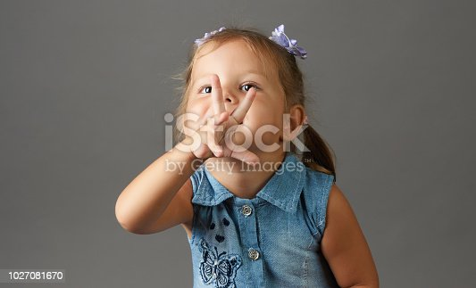 istock Happy 3 year old little girl showing three fingers 1027081670