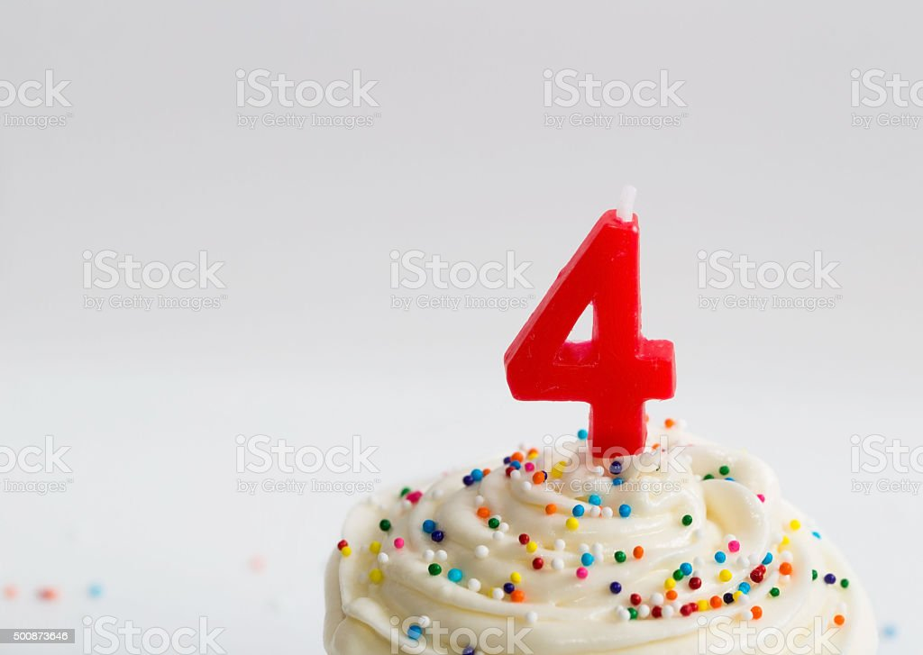 Happy 4th Birthday Cupcake! stock photo