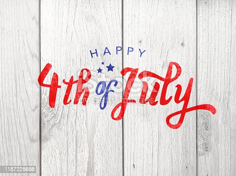 istock Happy 4th of July Holiday Typography Over Wood Background 1157225658