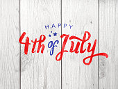 Happy 4th of July Independence Day Holiday Typography Over Wood Background