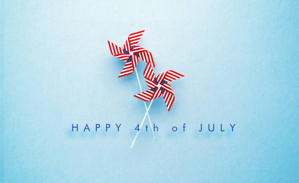 happy 4th of july message and paper pinwheel pair textured with american flag on blue background - july 4th stock pictures, royalty-free photos & images