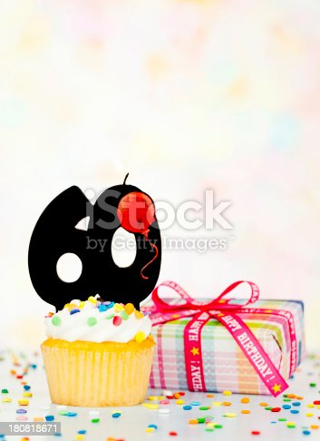Cupcake with 60 candle and birthday gift