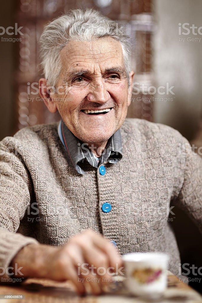 Happy 80 years old man stock photo