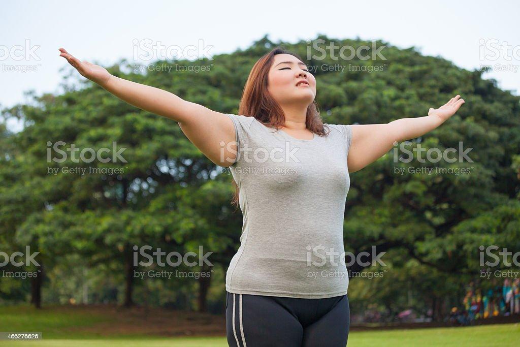Happy a woman posing outdoor圖像檔