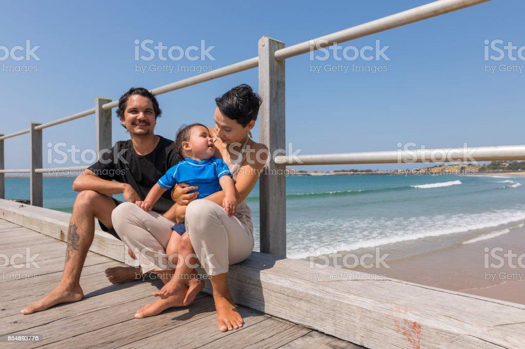 Happy Aboriginal Australian Family at the Beach stock photo