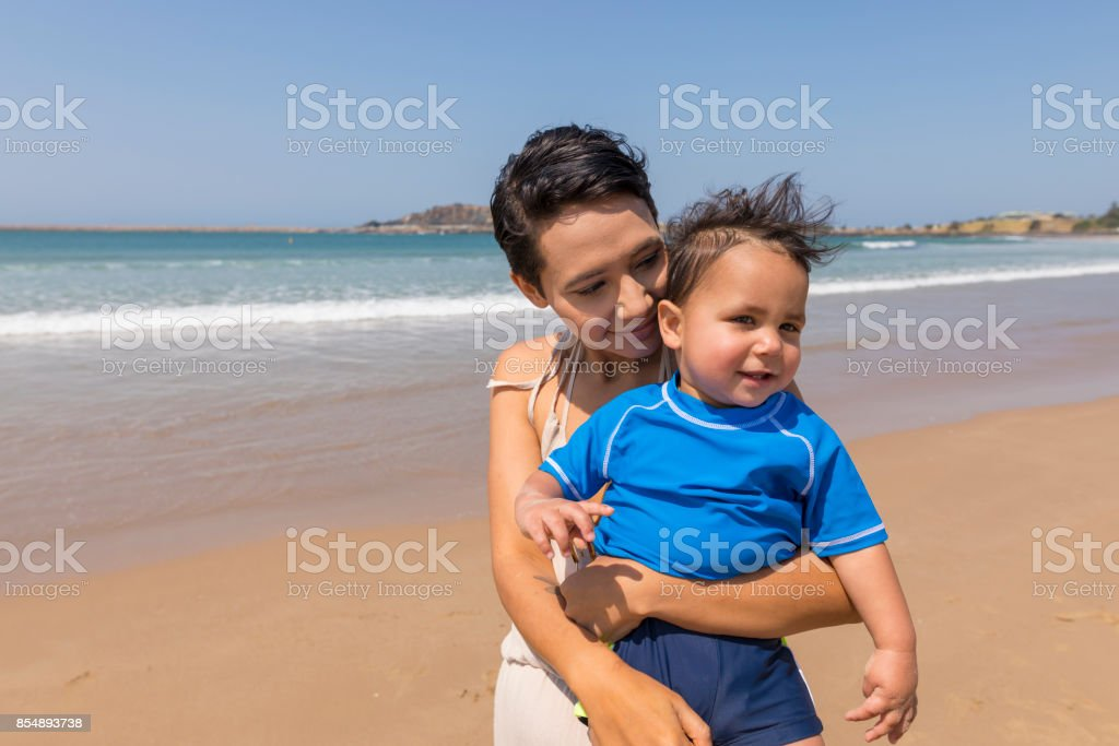 Happy Aboriginal Australian Mother and Son at the Beach stock photo