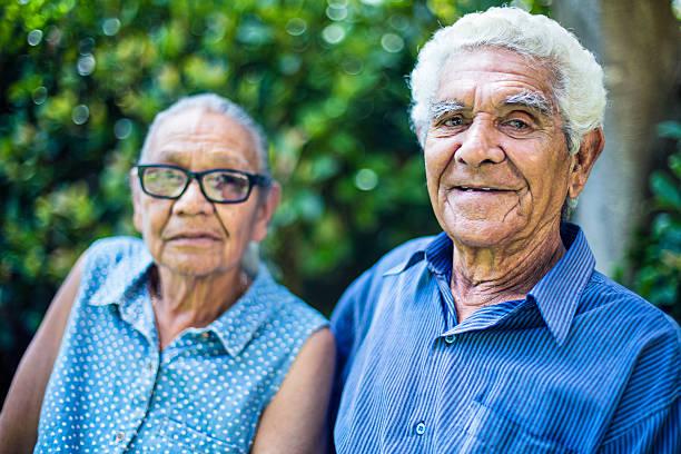 Happy aboriginal senior couple portrait stock photo