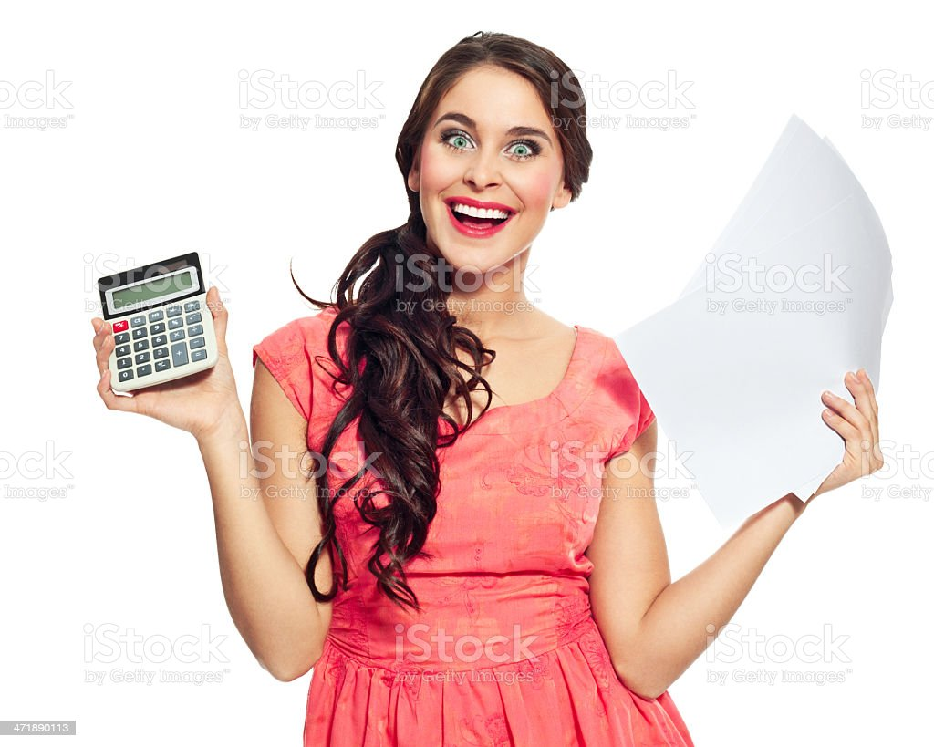 Happy accountant Young woman holding papers and calculator in hands and laughing at the camera. Studio shot on a white background. 20-24 Years Stock Photo