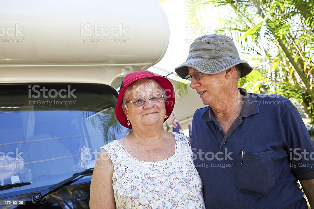 Happy Active Senior Couple in front of Motorhome RV royalty-free stock photo
