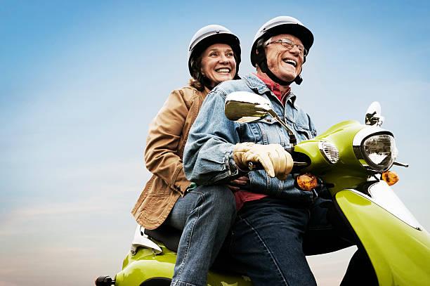 Happy Active Senior Couple on Scooter stock photo
