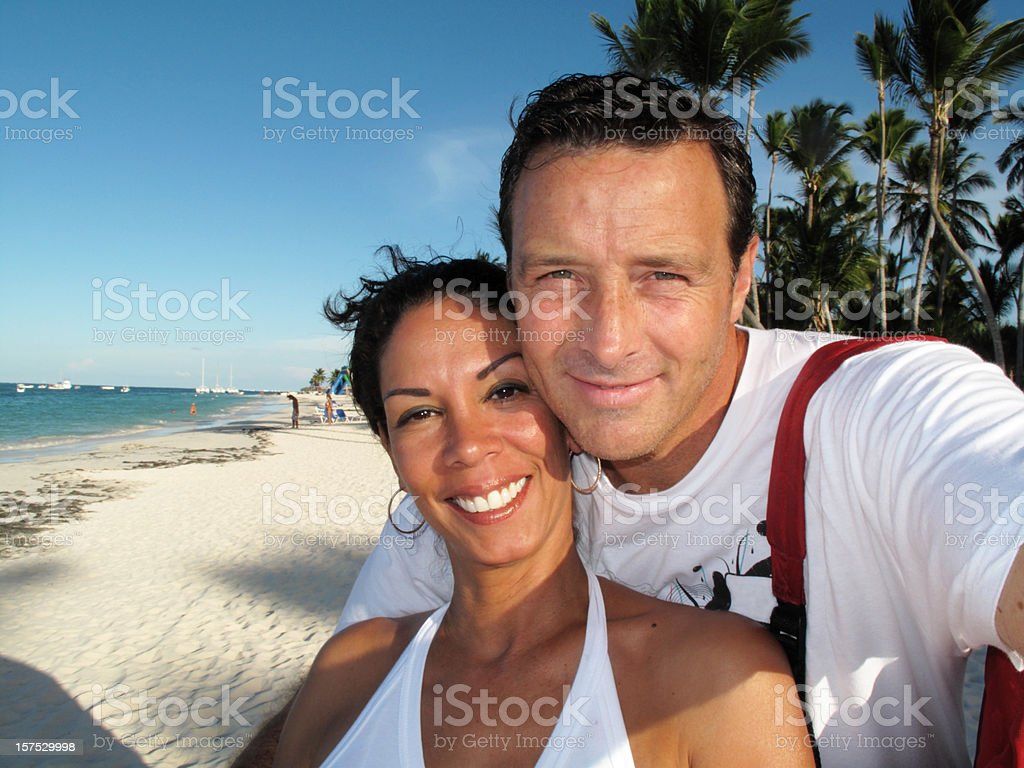 Happy adult couple in the beach royalty-free stock photo