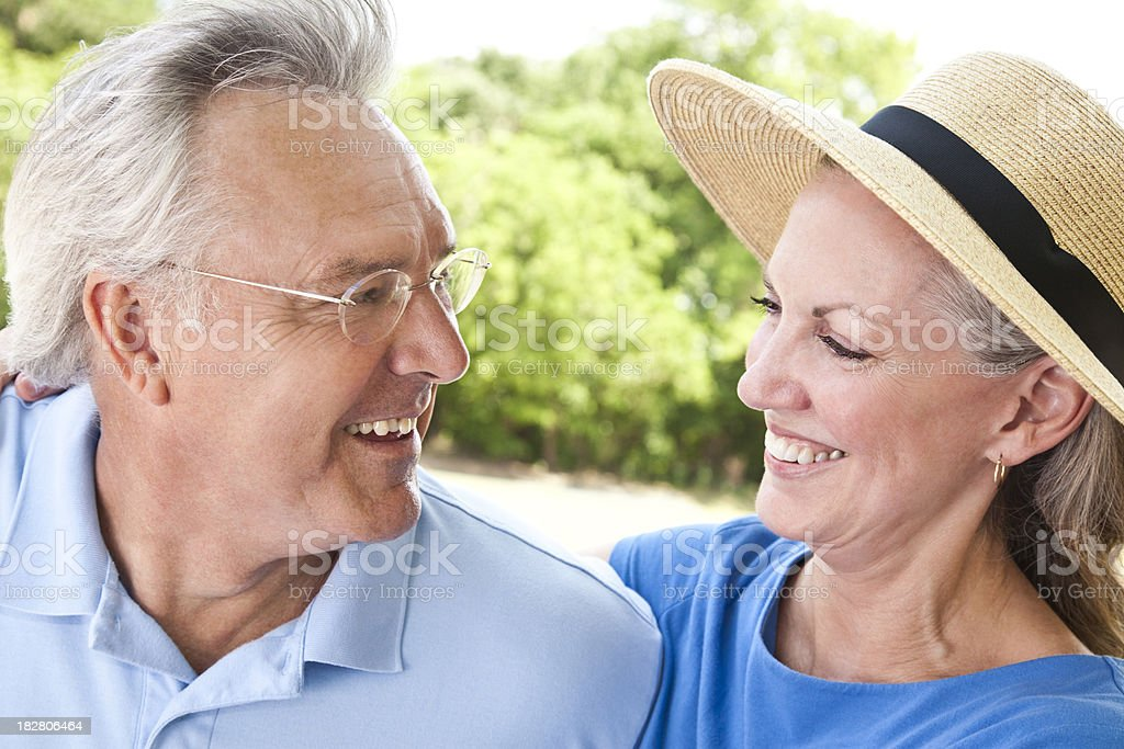 Happy Adult Couple Smiling With Each Other at the Park royalty-free stock photo