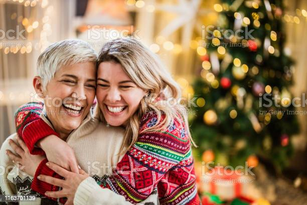 Happy adult daughter embracing her senior mother on new years day picture id1163701139?b=1&k=6&m=1163701139&s=612x612&h=7s1adx72blzkvnftizot3wxssrdxznkjdeletpw3qag=