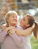 istock Happy adult mother and daughter embracing 1074889794