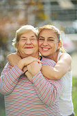 istock Happy adult mother and daughter embracing 1074889796