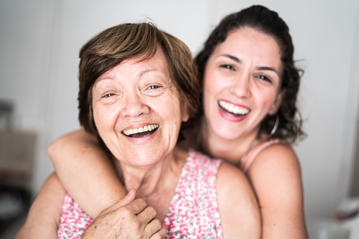 istock Happy adult mother and daughter embracing 928563154