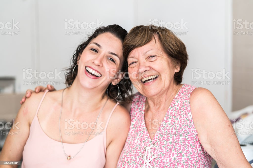 Happy adult mother and daughter together stock photo