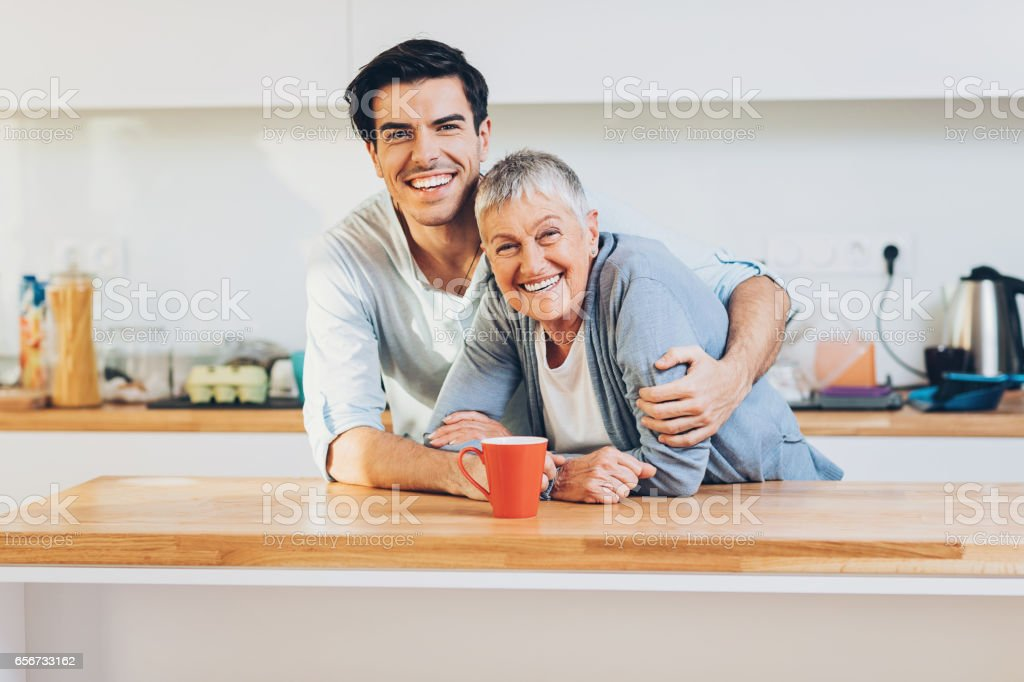 Happy adult mother and son stock photo