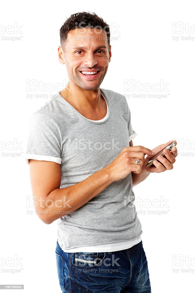 Happy adult texting on his phone. royalty-free stock photo