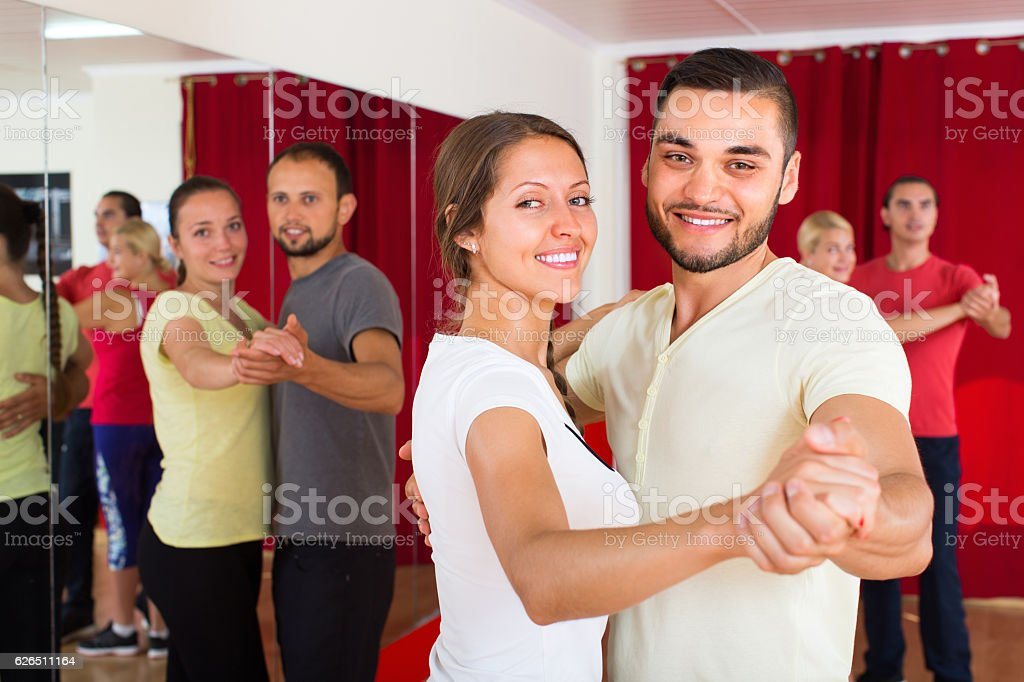 Happy adults dancing pair dance stock photo