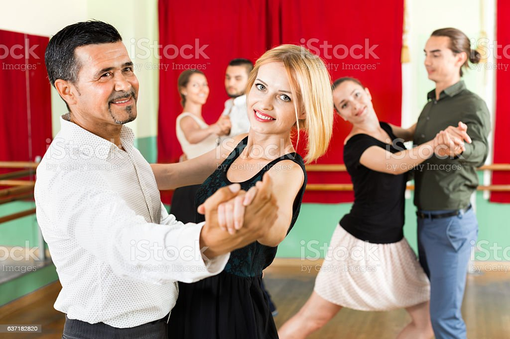 Happy adults  enjoying of classical dance stock photo