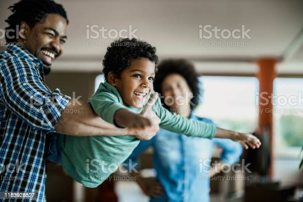 Happy african american boy having fun with his father at home picture id1183928827?b=1&k=6&m=1183928827&s=612x612&h=wy1pwekqoze97omuptfyastzir58pt0r4 etfoo fly=