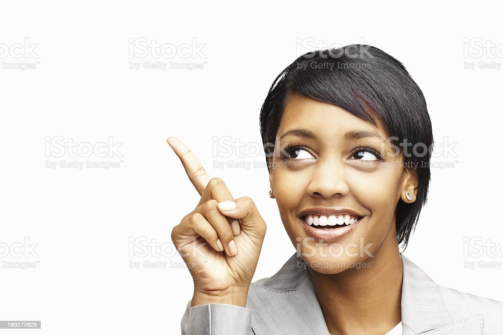 Happy African American business woman pointing upward stock photo