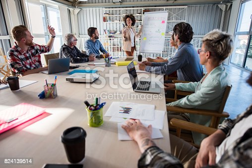 istock Happy African American businesswoman giving a presentation in a modern office. 824139514