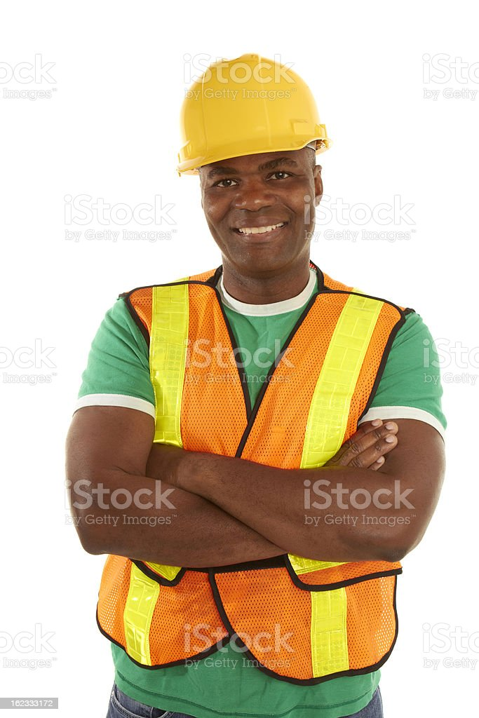 happy african american construction with arms crossed royalty-free stock photo