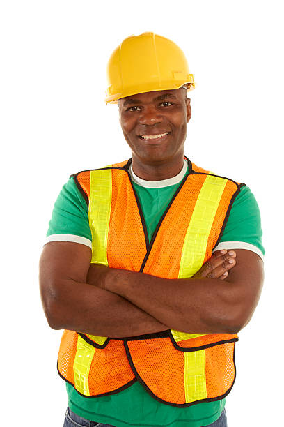 happy african american construction with arms crossed stock photo