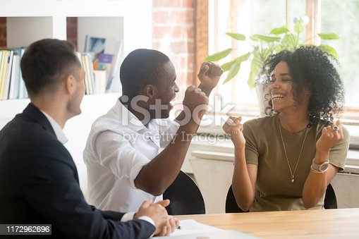 istock Happy African American couple celebrating successful real estate deal 1172962696