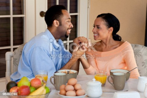 Happy African American Couple Holding Hands At Healthy Breakfast Stock Photo & More Pictures of 30-39 Years