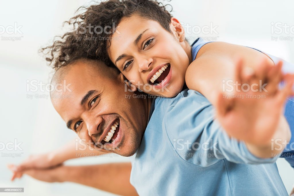 Happy African American couple piggybacking. royalty-free stock photo