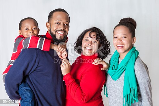 1126155137 istock photo Happy African American family at Christmastime 594042198